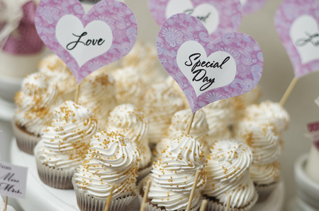 sugarpaste: Wedding Cake - Bunch of Yummy Traditional Colorful Chocolate Cupcakes Stock Photo