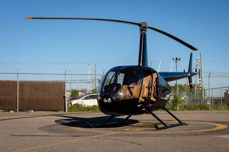 Black Robinson R44 Helicopter with no door