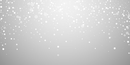 Magic stars random Christmas background. Subtle flying snow flakes and stars on light grey background. Attractive winter silver snowflake overlay template. Captivating vector illustration. Stock Photo
