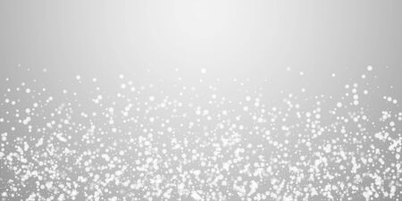 Beautiful falling snow Christmas background. Subtle flying snow flakes and stars on light grey background. Adorable winter silver snowflake overlay template. Likable vector illustration.