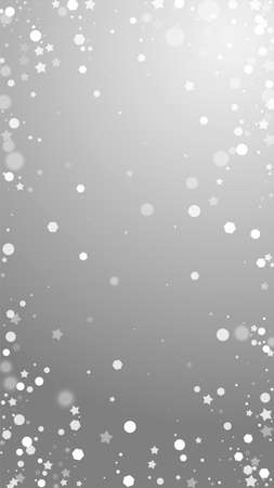 Magic stars sparse Christmas background. Subtle flying snow flakes and stars on grey background. Actual winter silver snowflake overlay template. Bewitching vertical illustration.