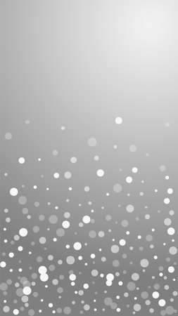 White dots Christmas background. Subtle flying snow flakes and stars on grey background. Amusing winter silver snowflake overlay template. Enchanting vertical illustration.