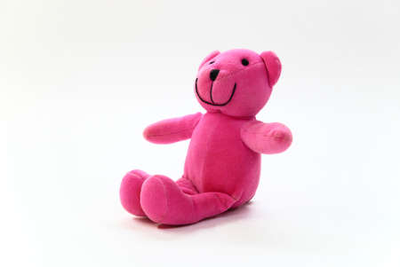 pink teddy bear on a white