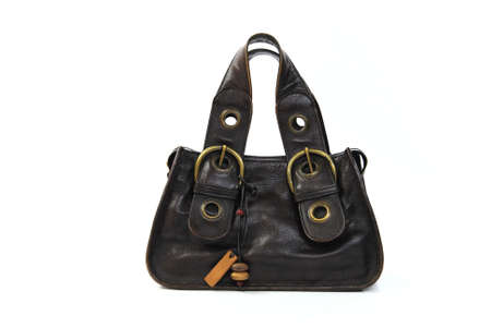 vintage brown handbag on a white