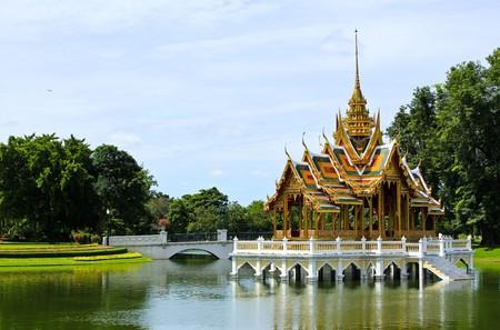Bang Pa-In Aisawan, artificial lake with bridge and temple in Thipya-Art at the Royal Summer Palace near Bangkok, Thailand photo