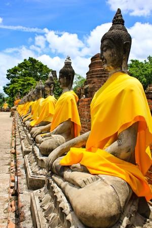 Stone statue of a Buddha in Ayutthaya, Thailand. photo