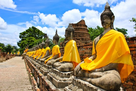 shrine: Stone statue of a Buddha in Ayutthaya, Thailand.