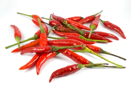 Red chili peppers on a white background. photo