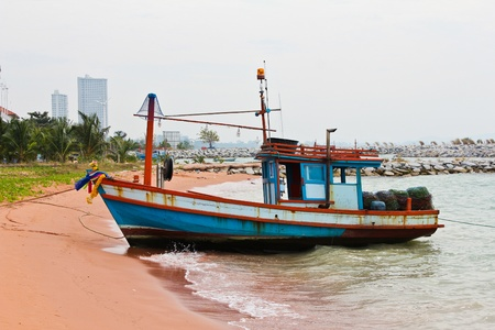 Wooden fishing boat on the beach. photo
