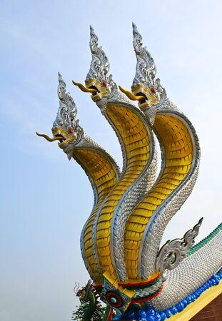 naga china: Thai dragon or king of Naga statue with three heads. Stock Photo