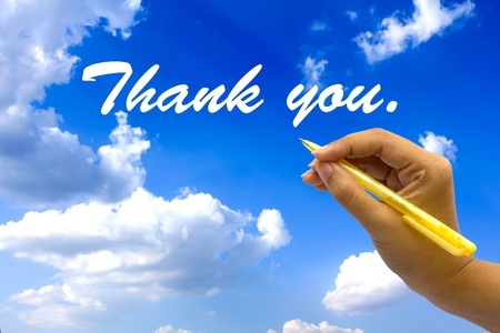 Hand writing thank you on blue sky. Stock Photo - 10863890