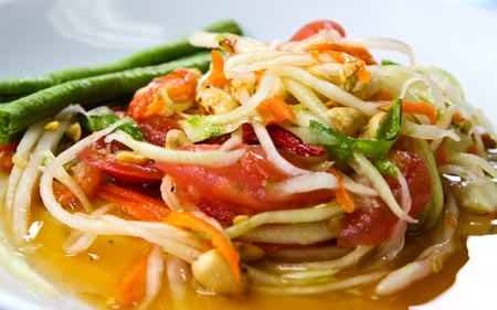 Thai papaya salad also known as Som Tum from Thailand. photo