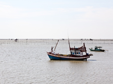 Wooden fishing boat on the sea. photo