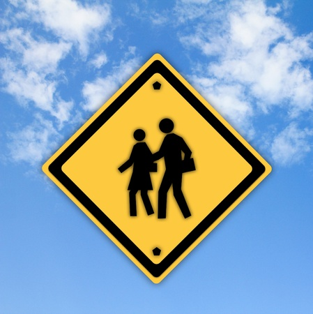 School warning sign on yellow with a blue sky background Stock Photo
