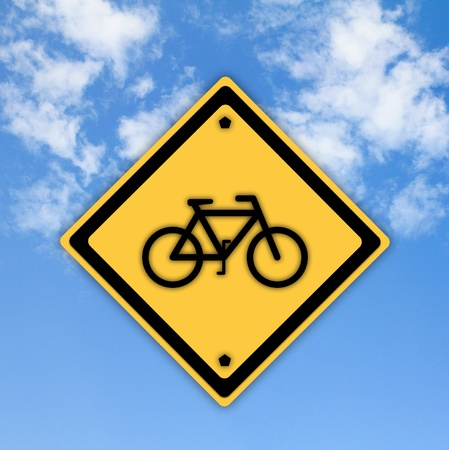 Bicycle traffic sign on beautiful sky background. photo