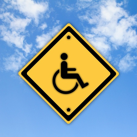 physically: Handicap disabled sign on beautiful sky background.