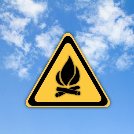 Glossy Fire danger sign on beautiful sky background. Stock Photo - 13012794