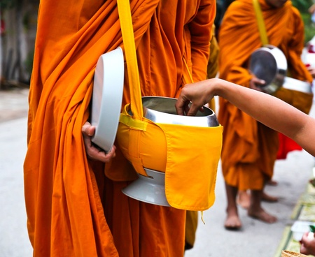 monk: Offer food to monk on early morning Stock Photo