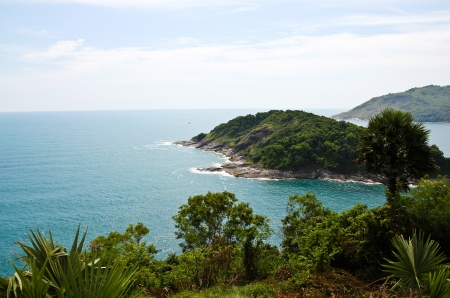 A small island lies off the coast of Phuket, Thailand.