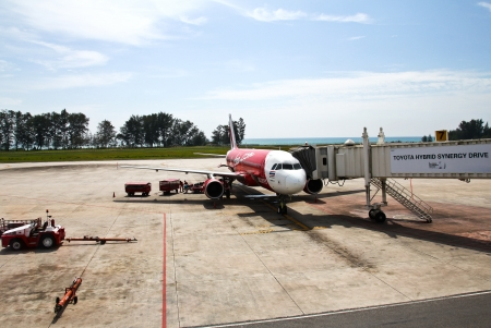 PHUKET, THAILAND - Jul 28: AIR ASIA plane at Phuket International Airport on July 28, 2012. Air Asia plane is the low-cost airline company in Thailand.