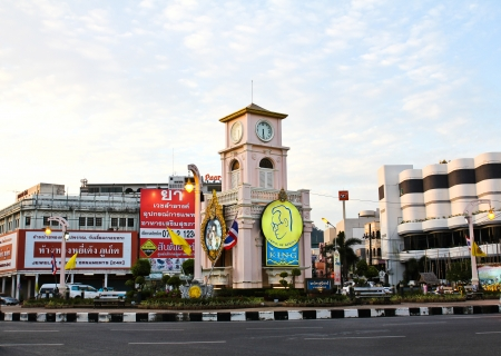 PHUKET, THAILAND - Jul 29: Clock Tower in Surin Circle, Phuket Town, Thailand on July 29, 2012. China town in phuket town is one of the most hitorical Chinese communities in south east of Asia.