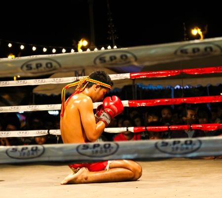 BANGKOK, THAILAND - Sep 12: Unidentified Muay Thai fighters compete in a Thai kickboxing match at Utthayan Avenue  Fight Night on September 12, 2012 in Bangkok, Thailand.