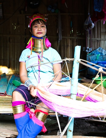 CHIANG RAI, THAILAND - AUGUST 25: Unidentified Karen tribe woman poses for the camera in Chiang Rai on August 25, 2012. The Karen people wear brass rings around their neck from as young as five years old.