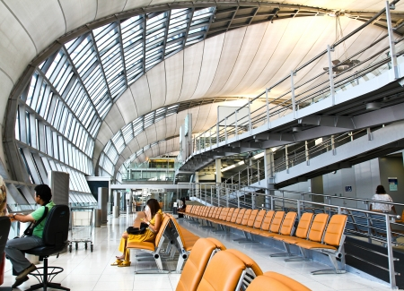 BANGKOK,THAILAND - AUGUST 24: Futuristic interior of Suvarnabhumi airport on August 24, 2012 in Bangkok, Thailand. Airport is 18th busiest in the world (by passenger traffic), was opened on Sept. 28, 2006