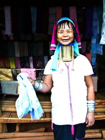 CHIANG RAI, THAILAND - AUGUST 25: Unidentified Karen tribe woman poses for the camera in Chiang Rai on August 25, 2012. The Karen people wear brass rings around their neck from as young as five years old. Editorial