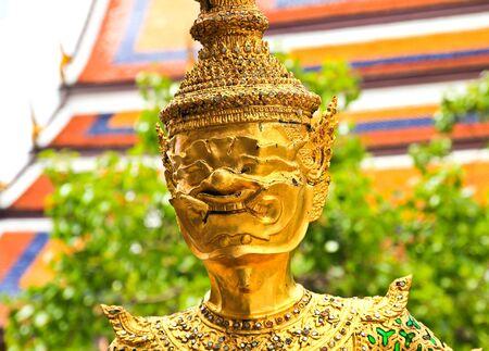 far eastern: Golden statue in Wat Phra Keao in the Grand Palace in Bangkok Thailand