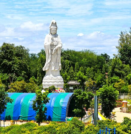forest railway: White marble statue of Buddha in the river Kwai valley