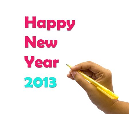 A hand writing the words Happy New Year 2013. Stock Photo
