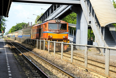 Red orange train, Diesel locomotive, on Bangkok railway station platform Thailand Stock Photo - 16029236