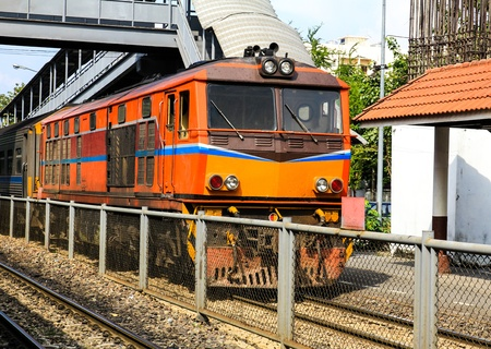 Red orange train, Diesel locomotive, on Bangkok railway station platform Thailand Stock Photo - 16029244