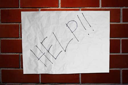 Paper Help on brickwall Stock Photo - 16373886