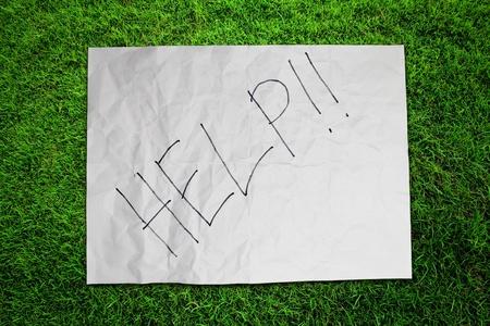 Paper Help on green grass field Stock Photo - 16373894