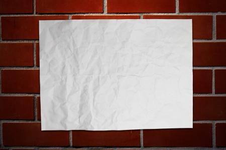 Paper on brickwall Stock Photo - 16373885