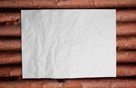 Paper on corrugated iron Stock Photo - 16373891