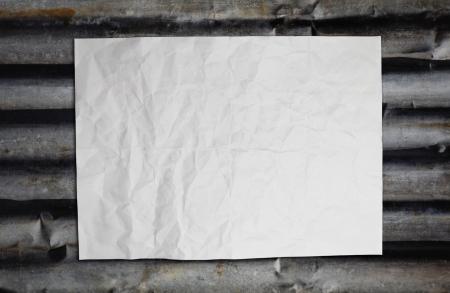 Paper on corrugated iron Stock Photo - 16373888