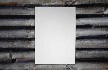 Paper on corrugated iron Stock Photo - 16373890