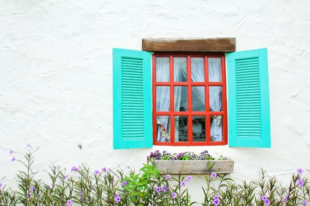 Decorative vintage window with colorful plants.