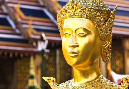 Golden kinnara statue in Grand palace Bangkok,Thailand. photo