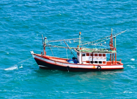 Wooden fishing boat on sea photo