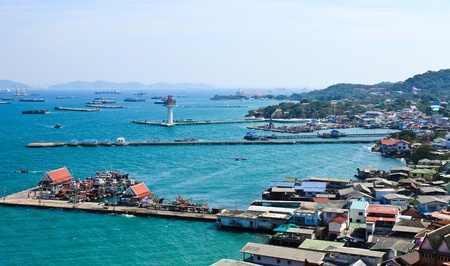 Aerial view of fisherman pier in with village and town at Srichang Island ,Chonburi ,Thailand.