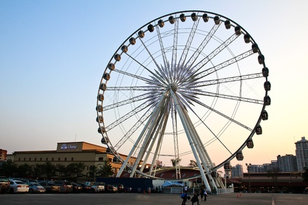 BANGKOK - MARCH 14: Big Ferris Wheel at ASIATIQUE The Riverfront Factory District on March 14, 2013 in Bangkok, Thailand. Over 500 fashion boutiques housed in Factory District of Asiatique The Riverfront. Editorial