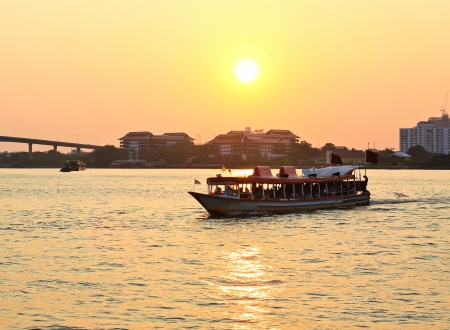 Sunset at Chao Phraya river with a boat. photo