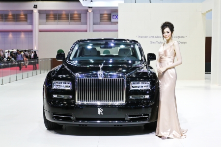 BANGKOK - MARCH 28: Rolls-Royce car with unidentified models  on display at The 34th Bangkok International Motor Show on March 28, 2013 in Bangkok, Thailand.