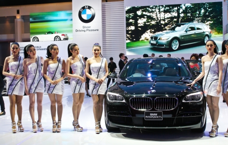 BANGKOK - MARCH 28: Unidentified female presenters model at the BMW booth during The 34th Thailand International Motor Expo at Impact Muang Thong Thani on March 28, 2013 in Bangkok, Thailand.