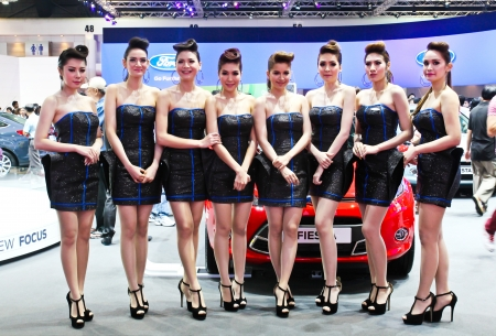 BANGKOK - MARCH 28: Unidentified female presenters model at the Ford booth during The 34th Thailand International Motor Expo at Impact Muang Thong Thani on March 28, 2013 in Bangkok, Thailand.