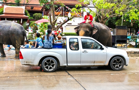 13 15 years: AYUTTAYA, THAILAND - APRIL 15: Songkran Festival is celebrated in a traditional New Years Day from April 13 to 15, with the splashing water with elephants on April 15, 2013 in Ayuttaya, Thailand.